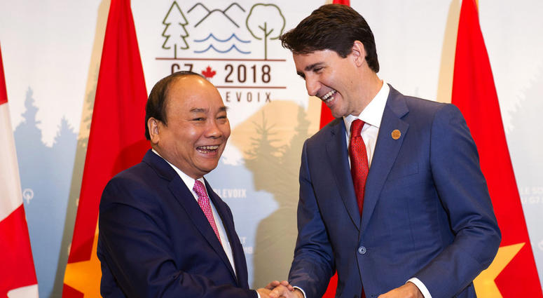 Prime Minister Justin Trudeau, right, meets with the Prime Minister of Vietnam, Nguyen Xuan Phuc, during a bilateral meeting as part of the G7.
