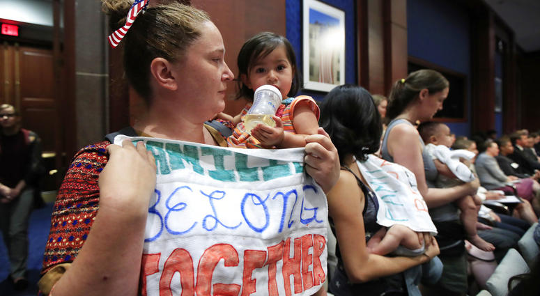 Lucy Martin and her daughter Branwen Espinal together with other mothers and their babies, attend a House Committee hearing to express their support and sympathy to immigrants and their families.