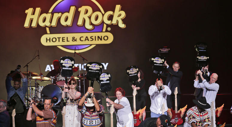 Celebrities and VIPs smash guitars as part of the grand opening celebration at the Hard Rock Hotel and Casino in Atlantic City, N.J.