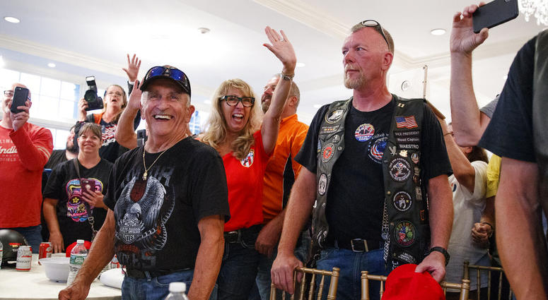 Supporters and members of Bikers for Trump wave and cheer, Saturday, Aug. 11, 2018, in the ballroom of Trump National Golf Club in Bedminster, N.J, during a meeting with President Donald Trump.