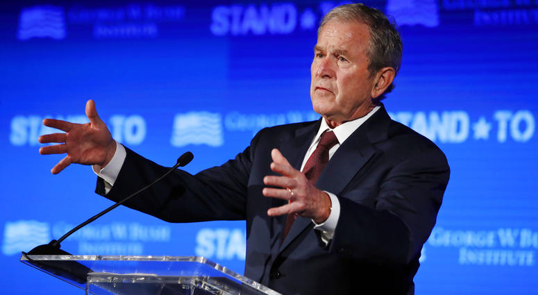 """In this June 23, 2017 file photo, former President George W. Bush speaks during """"Stand-To,"""" a summit held by the George W. Bush Institute focused on veteran transition, in Washington."""