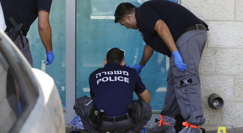 Israeli police investigates at the scene of an stabbing attack in the West Bank settlement of Gush Etzion Sunday, Sept. 15, 2018.