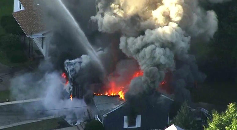 In this Sept. 13, 2018, file image take from video provided by WCVB in Boston, flames consume the roof of a home in Lawrence, Mass, a suburb of Boston.