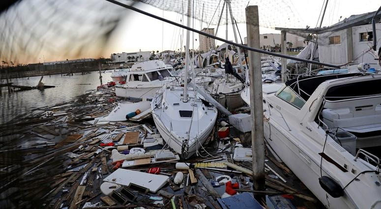 Damaged boats sit among debris in a marina in the aftermath of Hurricane Michael in Panama City, Fla., Friday, Oct. 12, 2018.