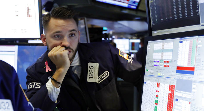 Specialist Matthew Grenier works on the floor of the New York Stock Exchange, Tuesday, Oct. 23, 2018.