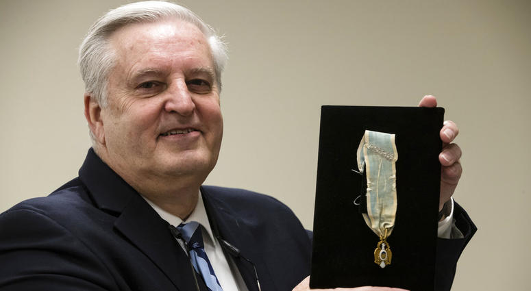 Displayed is Alexander Hamilton's Society of the Cincinnati Eagle insignia by Douglas Hamilton, his fifth great-grandson, at the Museum of the American Revolution in Philadelphia, Monday, Nov. 12, 2018.