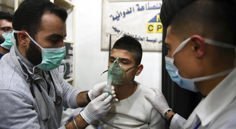 In this photo released by the Syrian official news agency SANA, shows a man receiving oxygen through respirators following a suspected chemical attack on his town of al-Khalidiya, in Aleppo, Syria, Saturday, Nov. 24, 2018