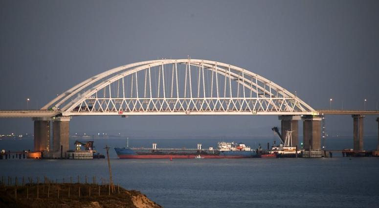 The Kerch bridge is seen blocked for ships entrance, near Kerch, Crimea, Sunday, Nov. 25, 2018.