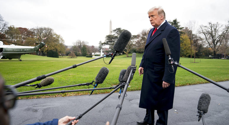 President Donald Trump listens to a question as he speaks to members of the media before boarding Marine One on the South Lawn of the White House in Washington, Monday, Nov. 26, 2018, for a short trip to Andrews Air Force Base, Md., and then on to Mississ