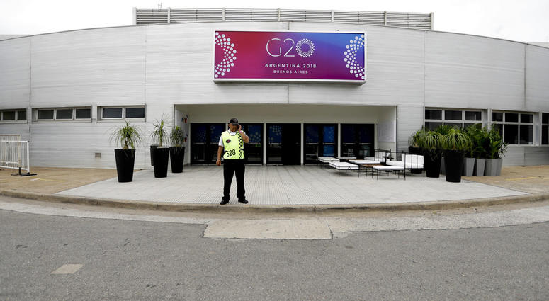 A security guard stands outside the G20 summit venue at the Costa Salguero Center, Buenos Aires, Argentina, Tuesday, Nov. 27, 2018.