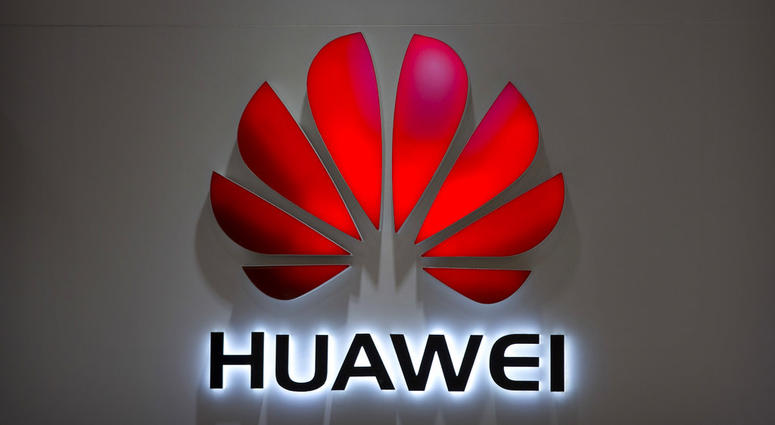 FILE - In this July 4, 2018, file photo, the Huawei logo is seen at a Huawei store at a shopping mall in Beijing. Canadian authorities said Wednesday, Dec. 5, 2018, that they have arrested the chief financial officer of China's Huawei Technologies for pos