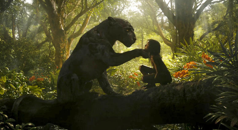 """This image released by Netflix shows Rohan Chand as Mowgli, right, and the character Bagheera, voiced by Christian Bale, in a scene from the film, """"Mowgli: Legend of the Jungle,"""" streaming on Netflix on Friday."""