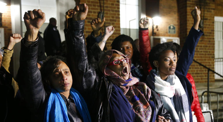 Local activists raise their fists outside Charlottesville General District Court after a guilty verdict was reached in the trial of James Alex Fields Jr., in Charlottesville, Va., Friday, Dec. 7, 2018.