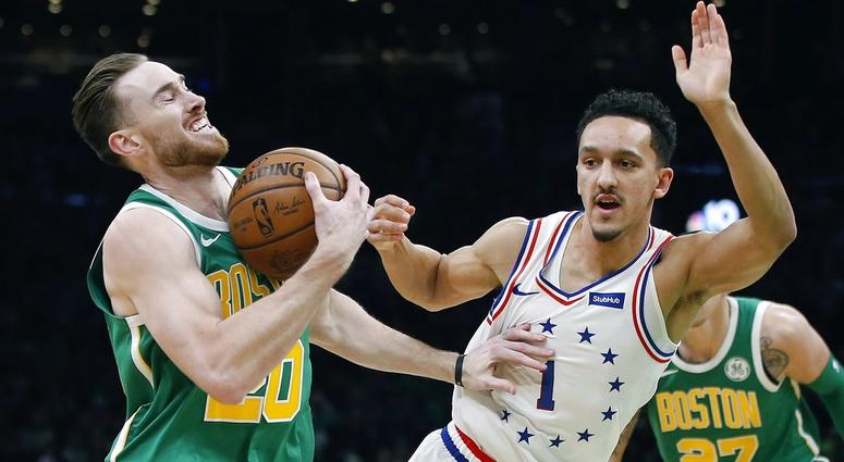 Boston Celtics' Gordon Hayward (20) is defended by Philadelphia 76ers' Landry Shamet (1) during the first half of an NBA basketball game in Boston, Tuesday, Dec. 25, 2018.