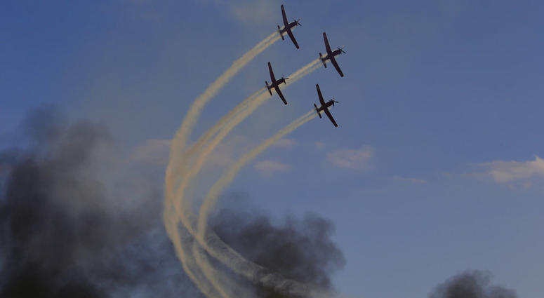 Israeli Air Force acrobatic team flies during a graduation ceremony for new pilots in Hatserim air force base near the southern Israeli city of Beersheba, Wednesday, Dec. 26, 2018.