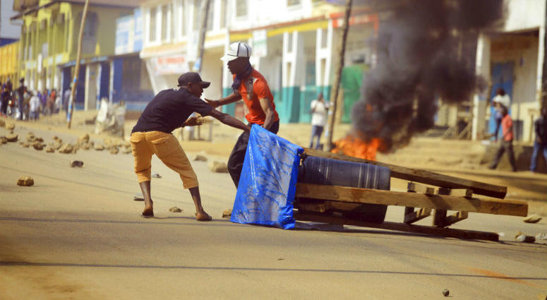 Protesters set up a barricade in the Eastern Congolese town of Beni Thursday Dec. 27, 2018.