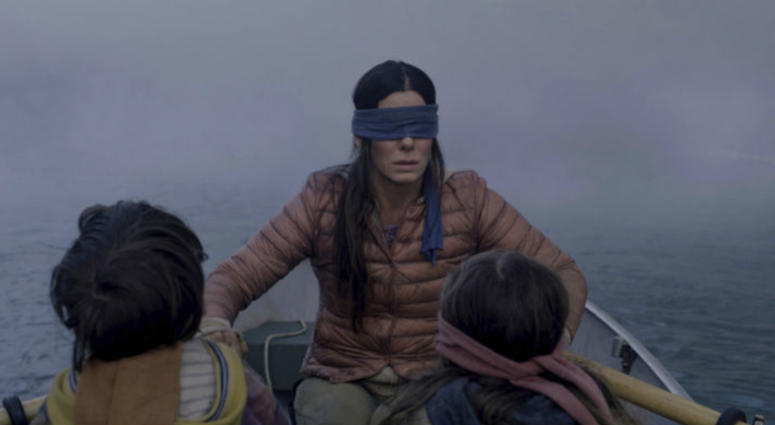 """FILE- This file image released by Netflix shows Sandra Bullock in a scene from the film, """"Bird Box."""""""