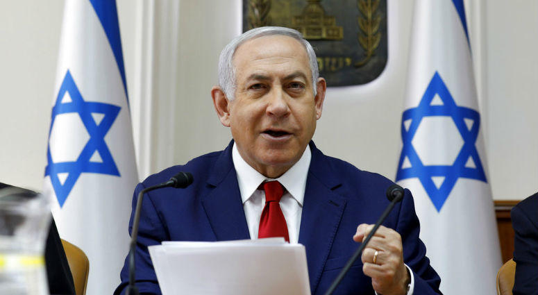 Israeli Prime Minister Benjamin Netanyahu opens the weekly cabinet meeting at the prime minister's office in Jerusalem, Sunday, Jan. 6, 2019.
