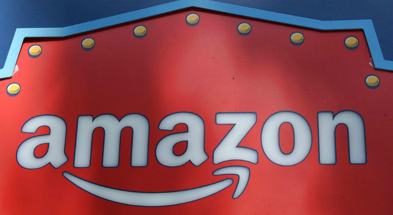 FILE - This Oct. 23, 2018, file photo shows an Amazon logo atop the Amazon Treasure Truck The Park DTLA office complex in downtown Los Angeles.