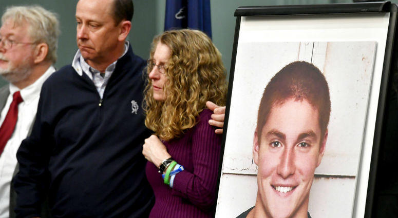 FILE - In this May 5, 2017, file photo, Jim and Evelyn Piazza stand by as Centre County District Attorney Stacy Parks Miller announces the results of an investigation into the death of their son Timothy Piazza, seen in photo at right, a Penn State Univers