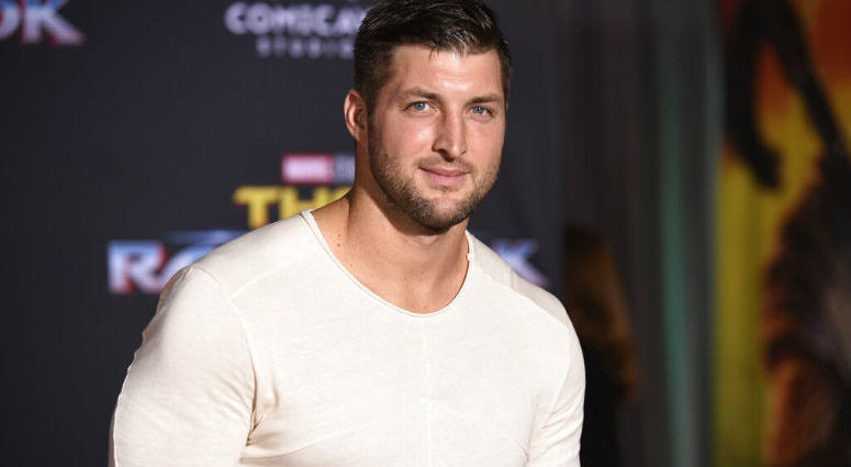 """FILE - In this Tuesday, Oct. 10, 2017 file photo, Tim Tebow arrives at the world premiere of """"Thor: Ragnarok"""" at the El Capitan Theatre in Los Angeles."""
