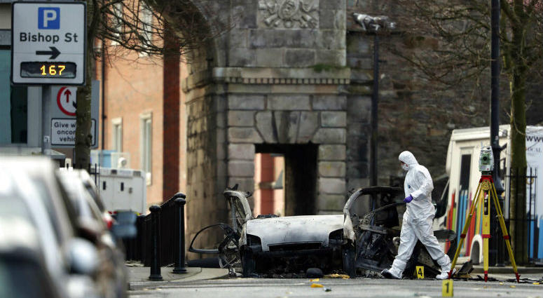 Forensic investigators at the scene of a car bomb blast on Bishop Street in Londonderry, Northern Ireland, Sunday, Jan. 20, 2019.