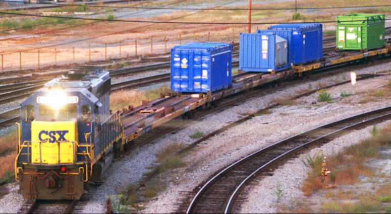 FILE - In this Sept. 29, 1994 file photo, a CSX Train with spent nuclear fuel passes through Florence, S.C., on its way to Savannah River Site Weapons Complex near Aiken S.C.