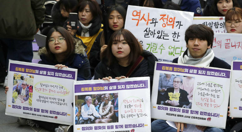 Participants hold pictures of deceased Kim Bok-dong, one of former South Korean sex slaves who were forced to serve for the Japanese military in World War II, during a weekly rally near the Japanese Embassy in Seoul, South Korea, Wednesday, Jan. 30, 2019.