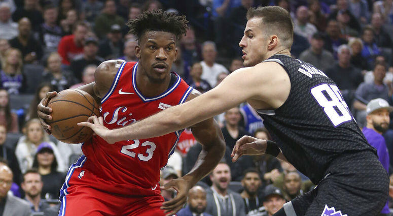 Philadelphia 76ers guard Jimmy Butler, left, drives to the basket against Sacramento Kings forward Nemanja Bjelica during the first quarter of an NBA basketball game Saturday, Feb. 2, 2019, in Sacramento, Calif.