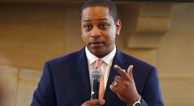 FILE- In this Sept. 25, 2018, file photo, Virginia Lt. Gov. Justin Fairfax gestures during remarks before a meeting of the Campaign to reduce evictions at a church meeting room in Richmond, Va.