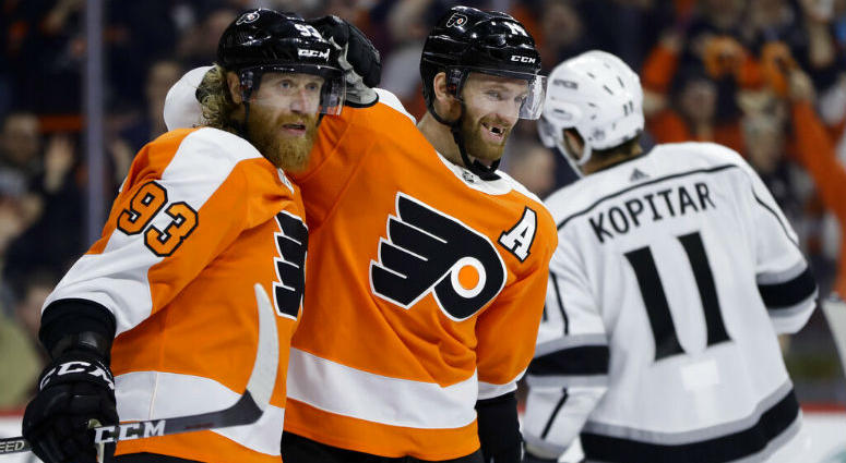 Philadelphia Flyers' Sean Couturier, center, celebrates with Jakub Voracek, left, past Los Angeles Kings' Anze Kopitar after Couturier's goal during the second period of an NHL hockey game, Thursday, Feb. 7, 2019, in Philadelphia.
