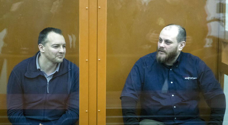 The former chief of the cybercrime department at Russia's main domestic security agency Sergei Mikhailov, left, and the former employee of Kaspersky Lab cybersecurity firm Ruslan Stoyanov attend a hearing in a court in Moscow, Russia, Tuesday, Feb. 26, 20