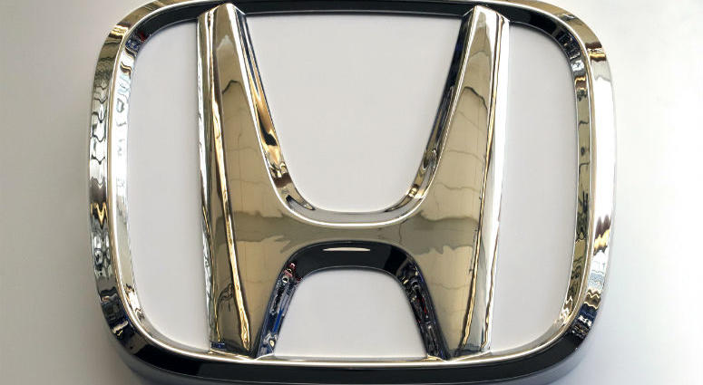 In this Feb. 14, 2019, photo, this photo shows the Honda logo on a sign at the 2019 Pittsburgh International Auto Show in Pittsburgh.