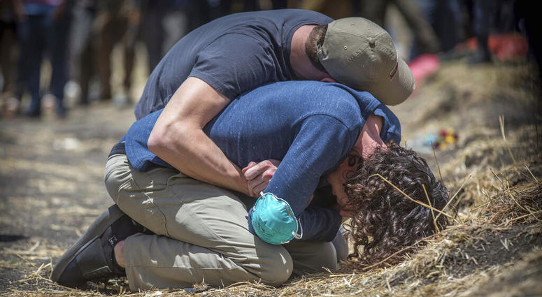 Relatives react at the scene where the Ethiopian Airlines Boeing 737 Max 8 crashed.