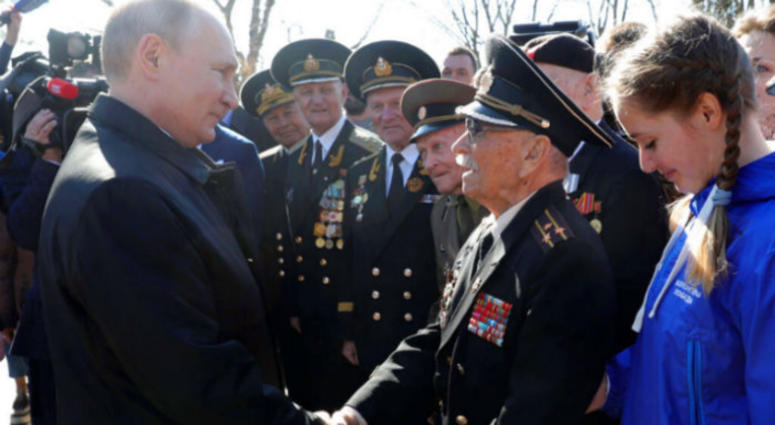Russian President Vladimir Putin, right, meets with local residents and veterans at the historical memorial the Malakhov Kurgan (Malakoff redoubt) in Sevastopol, Crimea, Monday, March 18, 2019.