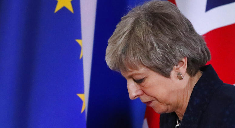 British Prime Minister Theresa May leaves after addressing a media conference at an EU summit in Brussels, March 22, 2019.