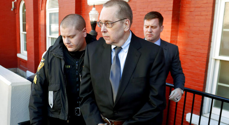 David Poulson, center, a Roman Catholic priest who pleaded guilty to sexually abusing two boys.