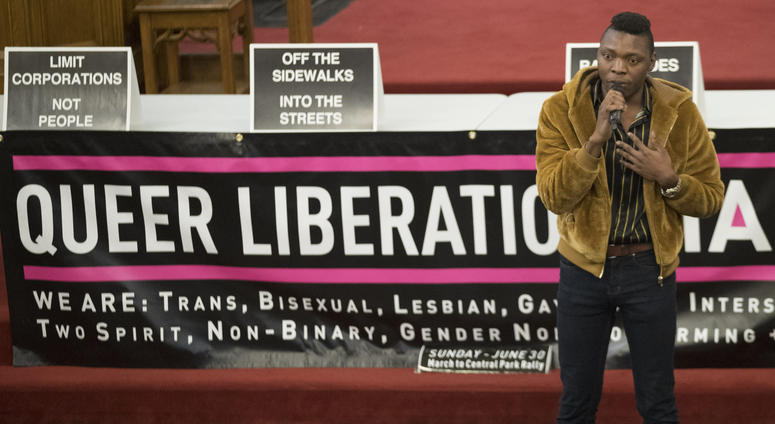 In this March 27, 2019, photo, Nigerian activist Michael Ighodaro speaks during a meeting of the Reclaim Pride Coalition at the Church of the Village in New York.