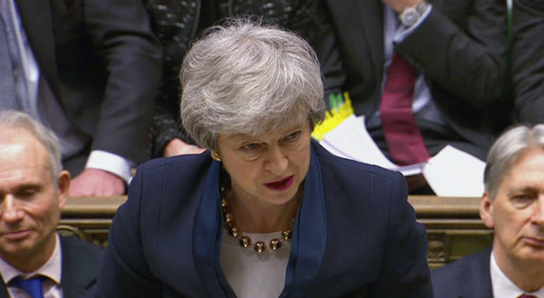 With Britain racing toward a chaotic exit from the European Union within days, May veered away from the cliff-edge Tuesday, saying she would seek another Brexit delay and hold talks with the opposition to seek a compromise.