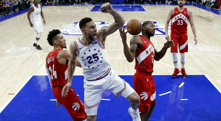 Philadelphia 76ers' Ben Simmons (25) reacts after dunking the ball between Toronto Raptors' Danny Green (14) and Kawhi Leonard (2) during the second half of Game 6 of a second-round NBA basketball playoff series Thursday, May 9, 2019, in Philadelphia.