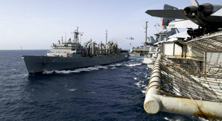 In this Sunday, May 19, 2019, photo released by the U.S. Navy, the fast combat support ship USNS Arctic transports cargo to the Nimitz-class aircraft carrier USS Abraham Lincoln during a replenishment-at-sea in the Arabian Sea.