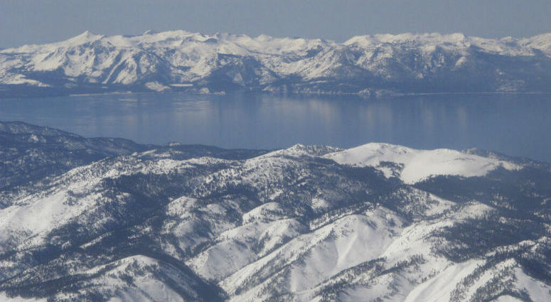 Scientists say water clarity has rebounded from an all-time low in 2017 at Lake Tahoe, pictured in this photo taken from an airplane departing from Reno, Nev. on March 2, 2017.