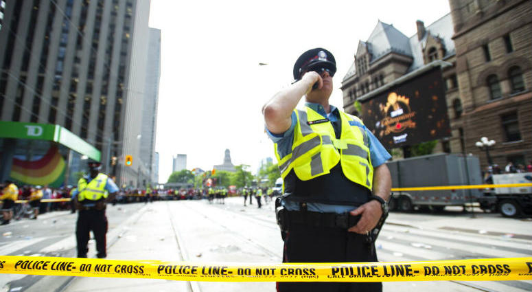 Toronto Police secure the scene after a shots were fired during the Toronto Raptors NBA basketball championship parade in Toronto, Monday, June 17, 2019.