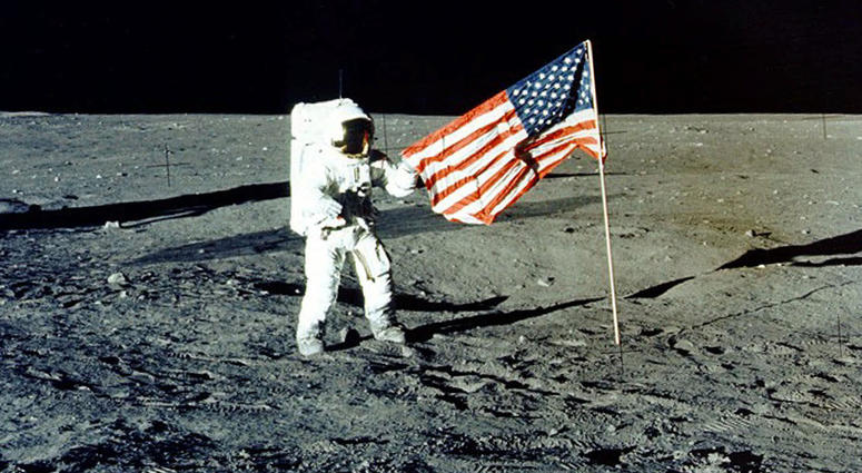 """In this Nov. 1969 photo made available by NASA, Apollo 12 mission Commander Charles P. """"Pete"""" Conrad stands on the moon's surface."""