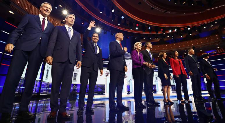 From left, Bill de Blasio, Tim Ryan, Julian Castro, Cory Booker, Elizabeth Warren, Beto O'Rourke, Amy Klobuchar, Tulsi Gabbard, Jay Inslee, John Delaney are shown on stage before the start of a Democratic primary debate, Wednesday, June 26, 2019.