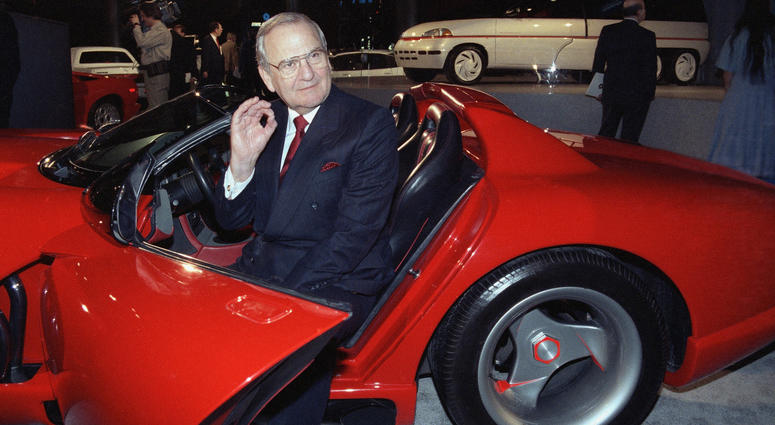 In this March 28, 1990, file photo, Chrysler Corporation Chairman Lee Iacocca sits in a 1990 Dodge Viper sports car as the Chrysler in the 90's six city tour makes a visit to New York.