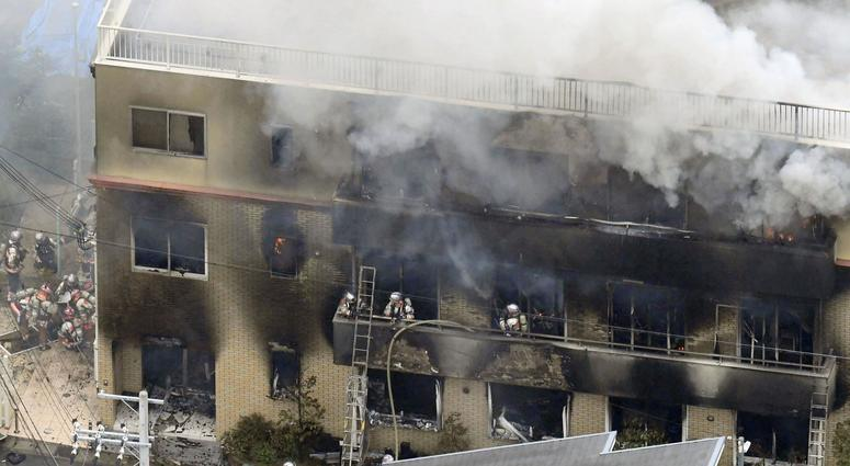 Firefighters respond to a building fire of Kyoto Animation in Kyoto, western Japan, Thursday, July 18, 2019.