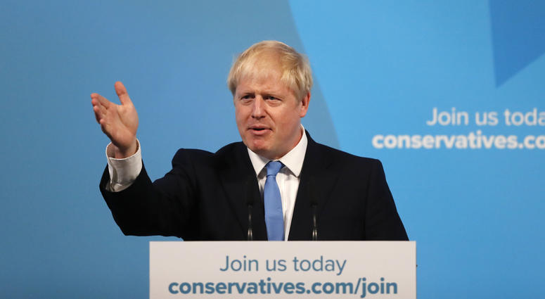 Boris Johnson gestures as he speaks after being announced as the new leader of the Conservative Party in London, Tuesday, July 23, 2019.