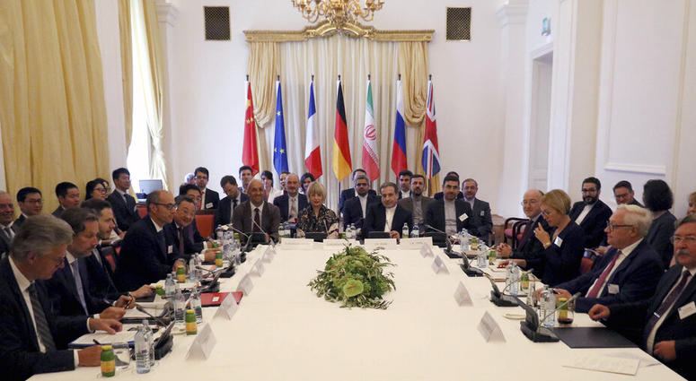 The European Union's political director Helga Schmid and Iran's deputy Foreign Minister Abbas Araghchi, center from left, wait for a bilateral meeting as part of the closed-door nuclear talks with Iran at a hotel in Vienna, Austria, Sunday, July 28, 2019.