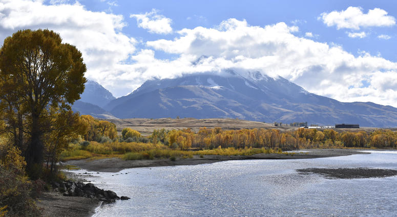 In this Oct. 8, 2018 file photo, emigrant Peak is seen rising above the Paradise Valley and the Yellowstone River near Emigrant, Mont.